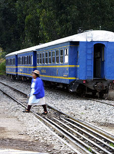 Quecha woman crossed the tracks in front of the Machu Picchu train