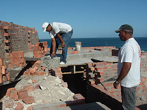 Our builder (right) supervises work on what is the ground floor near a bathroom.