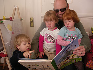 If we're fortunate, Calvin will realize just how lucky he was to hang out with two of the cutest girls around! Here they're all enjoying a German children's book! Lots more fun was had racing pushcars up and down the corridor, and even taking turns!